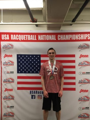 Fadden at the USA Racquetball National Championships wearing the medal he won at the event.