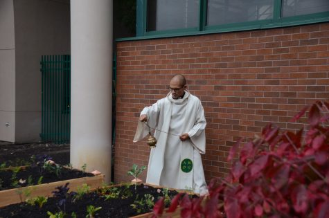 Fr. Claderon spreads incense over the newly built garden