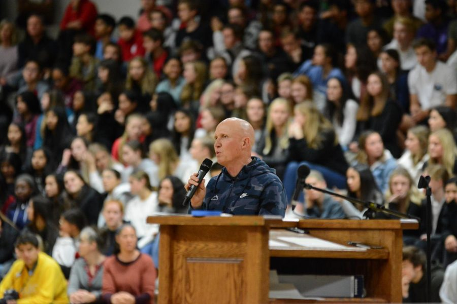Coach+Rothenberger+speaks+to+the+community+at+the+Fall+Sports+assembly+2019.
