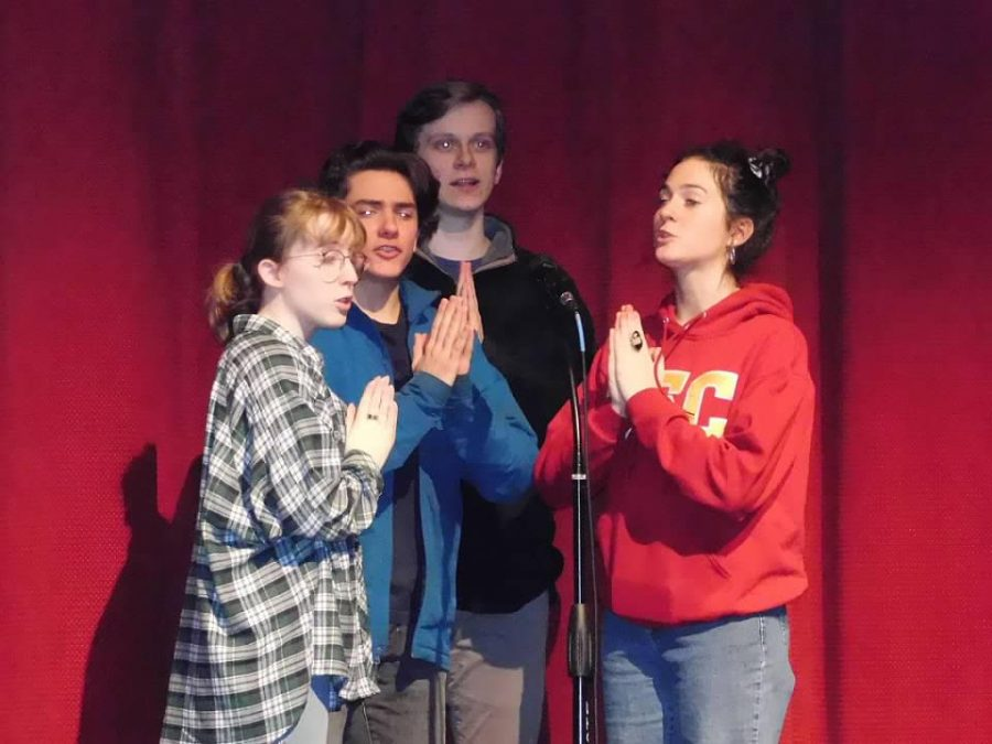 "Jesuit students in the Spring musical ""Something Rotten"" rehearsing a scene."