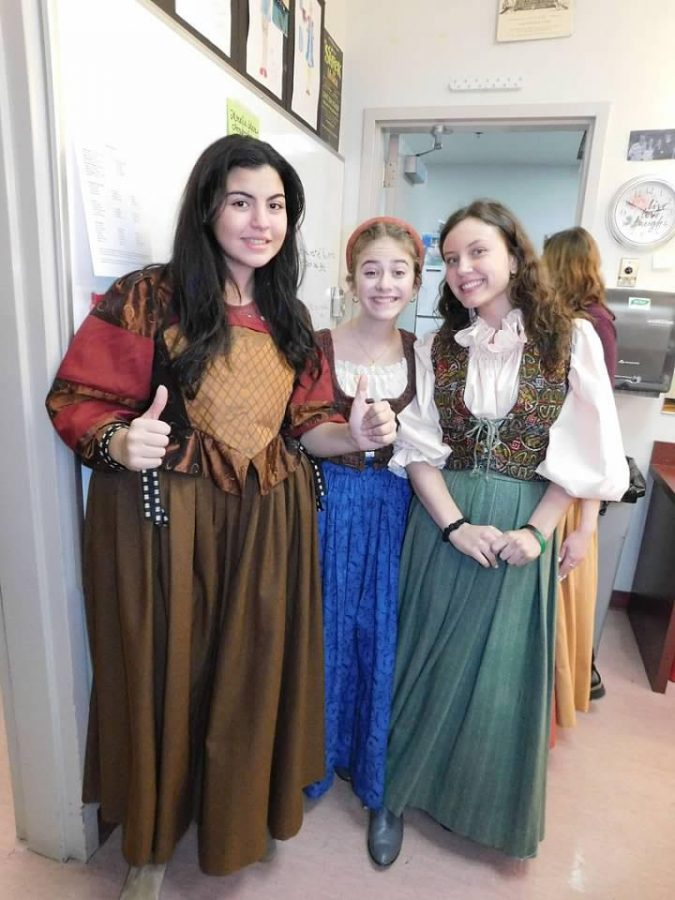 Jesuit students in the costume room wearing their costumes for the musical.