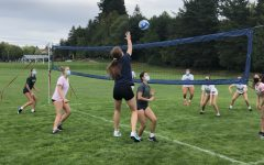Jesuit women's volleyball team practicing outside
