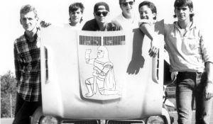 Jesuit students pose with an early rendition of Charlie Crusader.