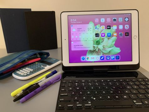 A student's digital learning setup during distance synchronous learning at Jesuit High School.