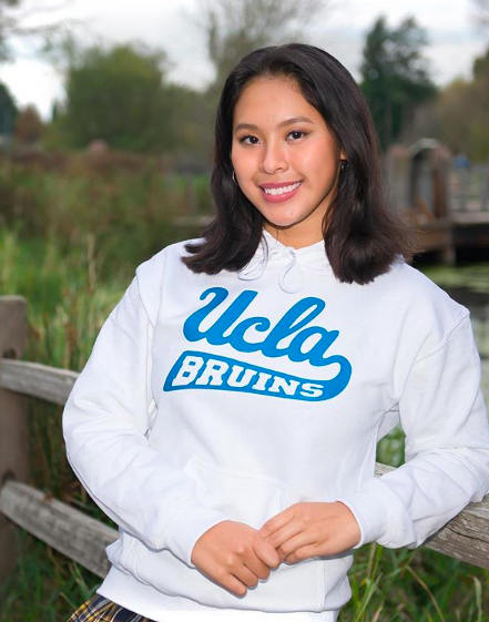 Junior Fay Lustria verbally commits to swim at UCLA after graduation.