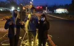 Seniors Anna Dellit, Owen Mackin and Cole Huesby help set up Sader Lights. Photo Curtsey of Gwynne Olson