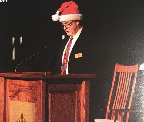 Mr. Hogan addressing the student body at the Christmas Mass. Courtesy of Jesuit's 2018 yearbook.