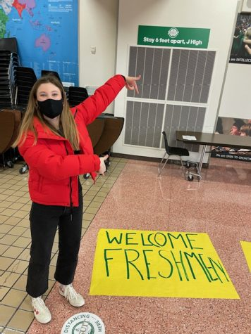 "Sophomore Student Government member Catie Dice creating a ""Welcome Freshman"" poster during class"
