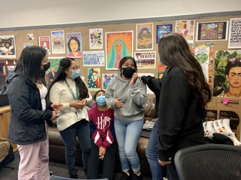 DEI Students and Faculty talk to each other in the DEI office.