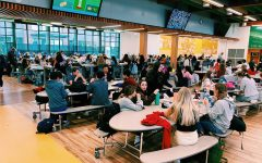 Students eating in the Hollman Family Student Union during lunch.