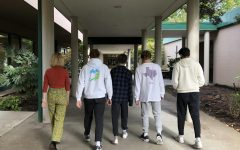 Students roam campus in a variety of attire including sweatpants.