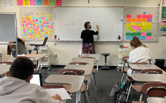 Ms. Schick explains a math problem to her algebra students in-person this year.